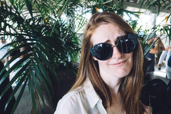 Emma wearing Top sunnies